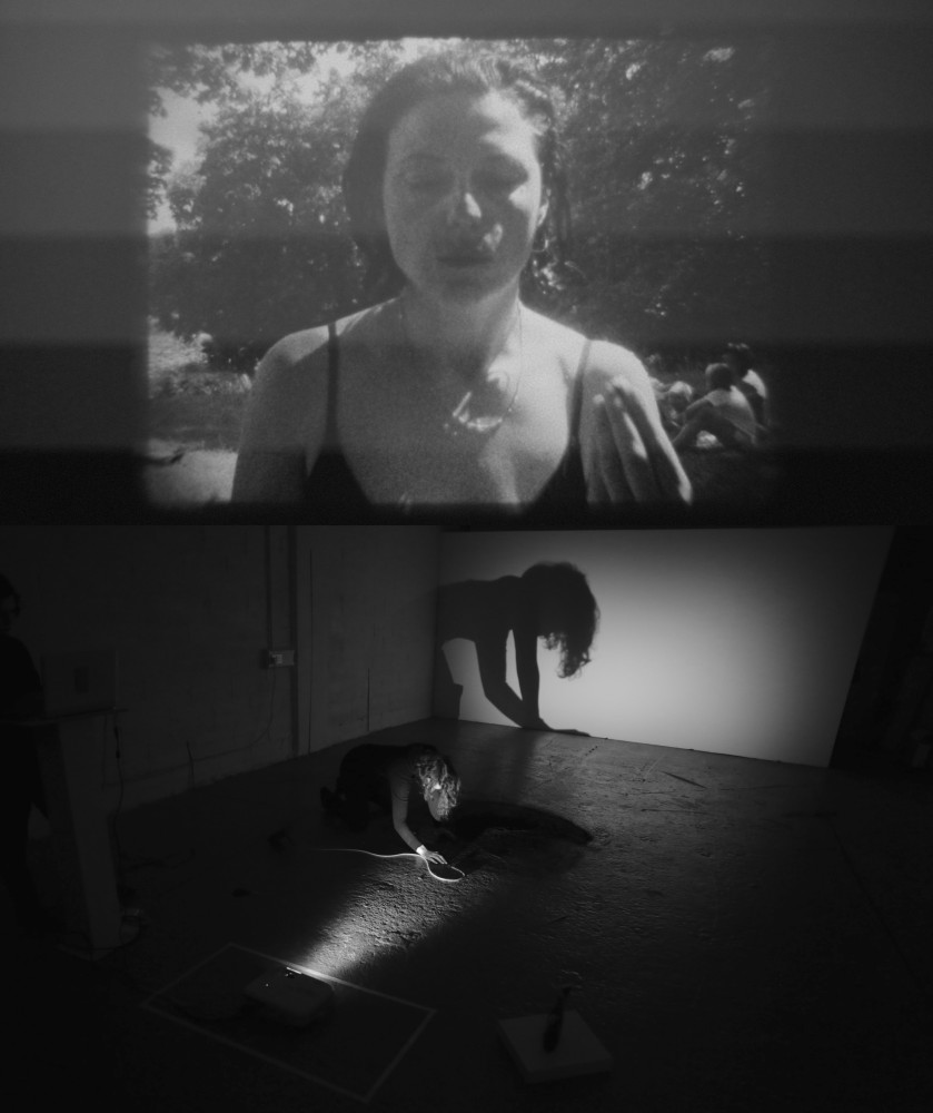 Atoosa Pour Hosseini: MIRAGE (2015). Projection: telecine transfers transferred from super-8mm lm. Sound, light, masking tape, and charcoal powder. 25 minutes approx. Performance at ArtBox, Dublin, December 2015. Image courtesy of the artist and the ArtBox Gallery.