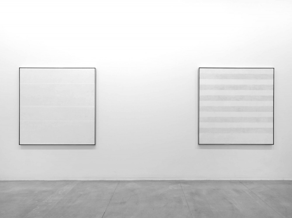 Agnes Martin. Installation shot (Tate Modern 2015). Paintings shown (left to right): Faraway Love (1999). Acrylic paint and graphite on canvas. 1525 x 1525 mm. Happy Holiday (1999). Acrylic paint and graphite on canvas. 1525 x 1525 mm. Image ©Tate, London 2015.