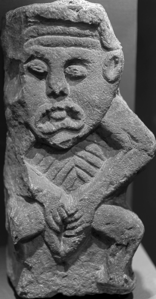 Sheela-na-Gig (Lavey, Cavan) housed in the Cavan County Museum. Stone. 43 cm high. Photo © Benjamin Dwyer.