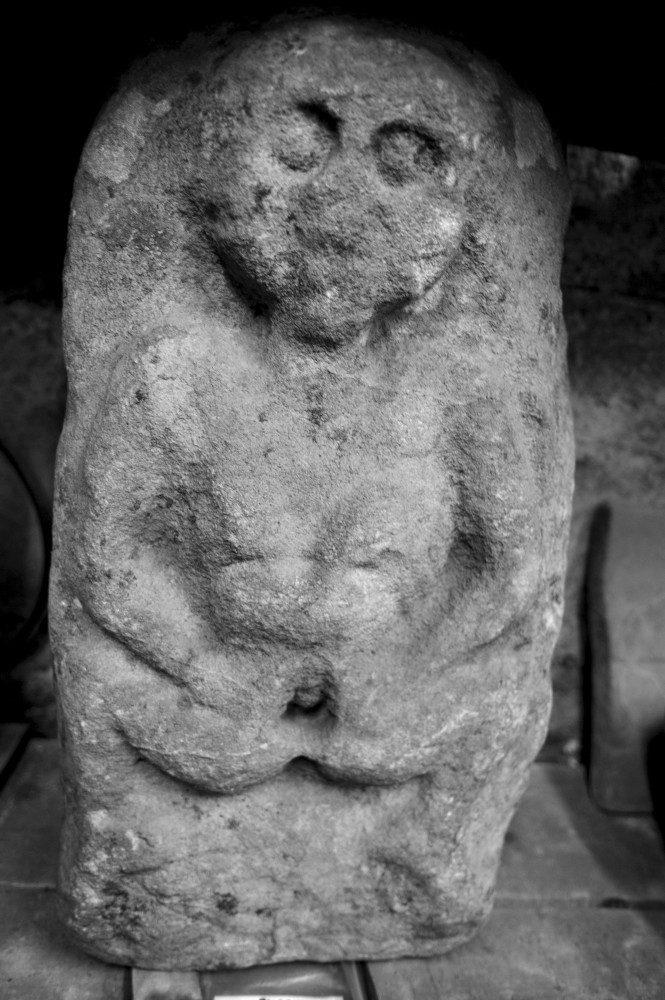 Sheela-na-Gig (Burgesbeg, Tipperary) housed in the National Museum of Ireland. Sandstone. 7cm high. Photo © Benjamin Dwyer