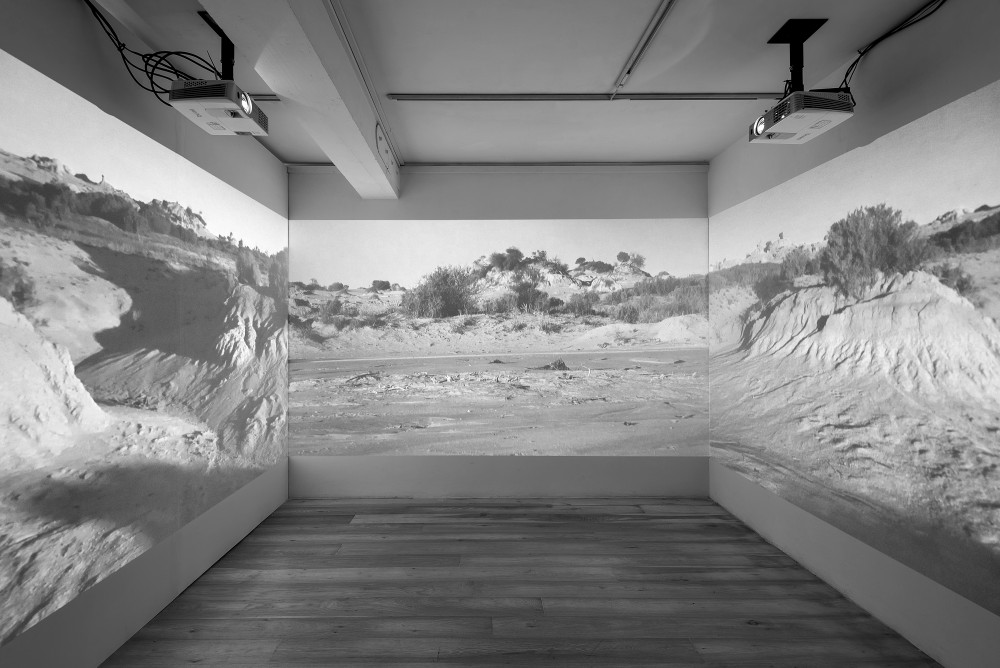 Robert Curgenven: They tore the earth and, like a scar, it swallowed them (2016). 3 channel HD video + sound. Installation shot. CIT Wandesford Quay Gallery (2017). Photo by Jed Niezgoda.