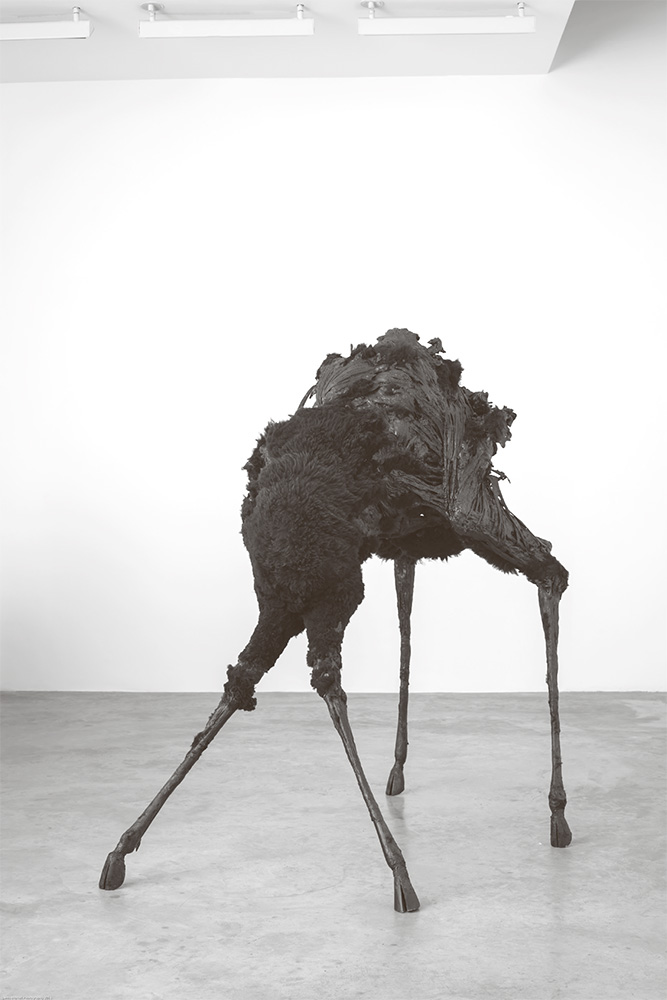 Eoin McHugh: The Ground Itself Is Kind, Black Butter (2014). Black sheepskin, wax, steel and mixed media. 224 x 122 x 190 cm.